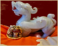 Jade dragon (side view) and Chinese chop